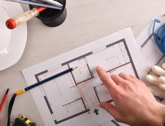 Technical Electrician Preparing An Electrical Project Of Housing